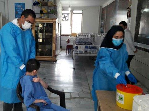گزارش تصویری | آغاز واکسیناسیون مددجویان بهزیستی استان زنجان