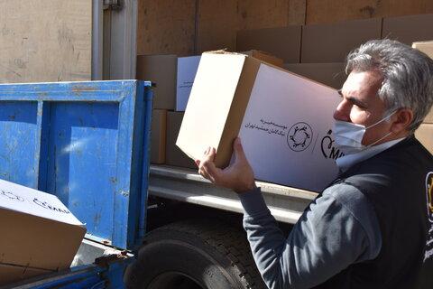گزارش تصویری|توزیع بسته های غذایی بین مددجویان کرمانشاهی
