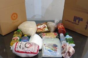 توزیع بسته حمایتی در بین مددجویان بهزیستی توسط کارکنان مرکز اورژانس اجتماعی کرمان