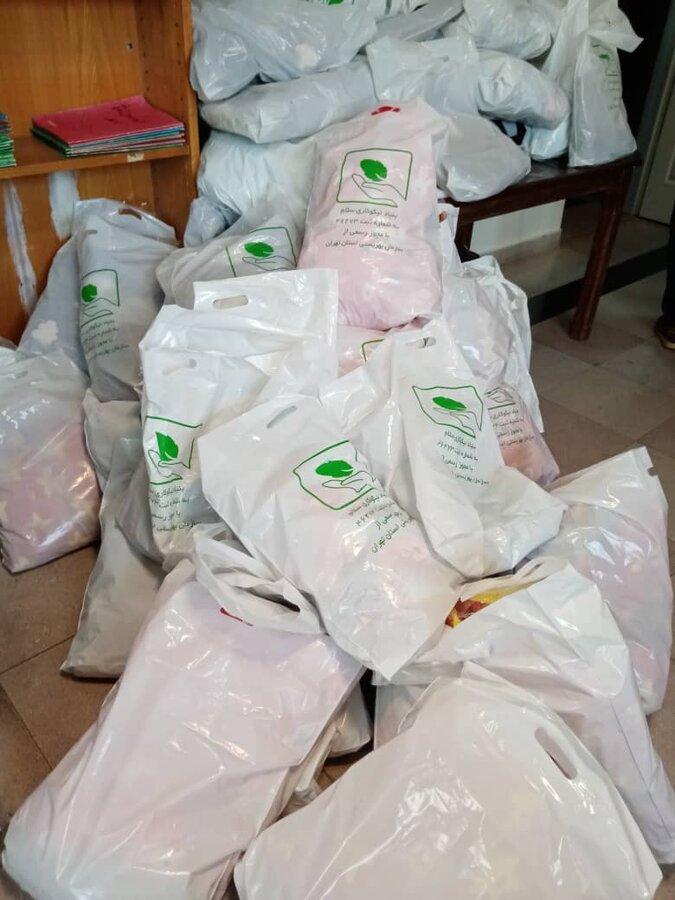 ملارد  تحویل لباس گرم به مددجویان