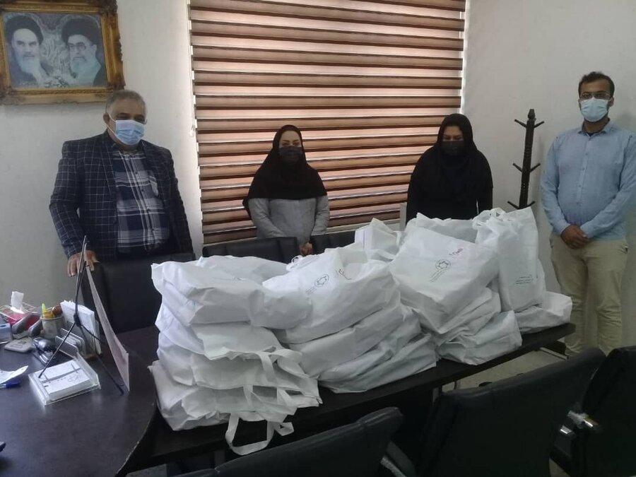 دشتی| اهدای کمک های غیرنقدی از موسسات خیریه تهران به مددجویان تحت پوشش بهزیستی شهرستان دشتی