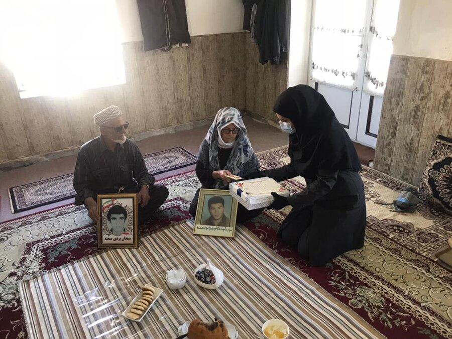 آققلا | حضور رئیس اداره بهزیستی در منزل شهید