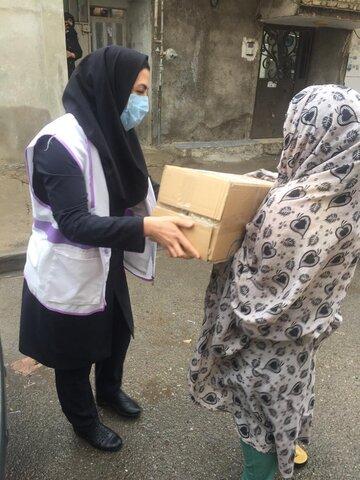 پاکدشت  توزیع بسته های حمایتی در بین مددجویان بهزیستی