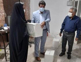 شهریار| توزیع سبد کالا میان معلولین ضایعه نخاعی