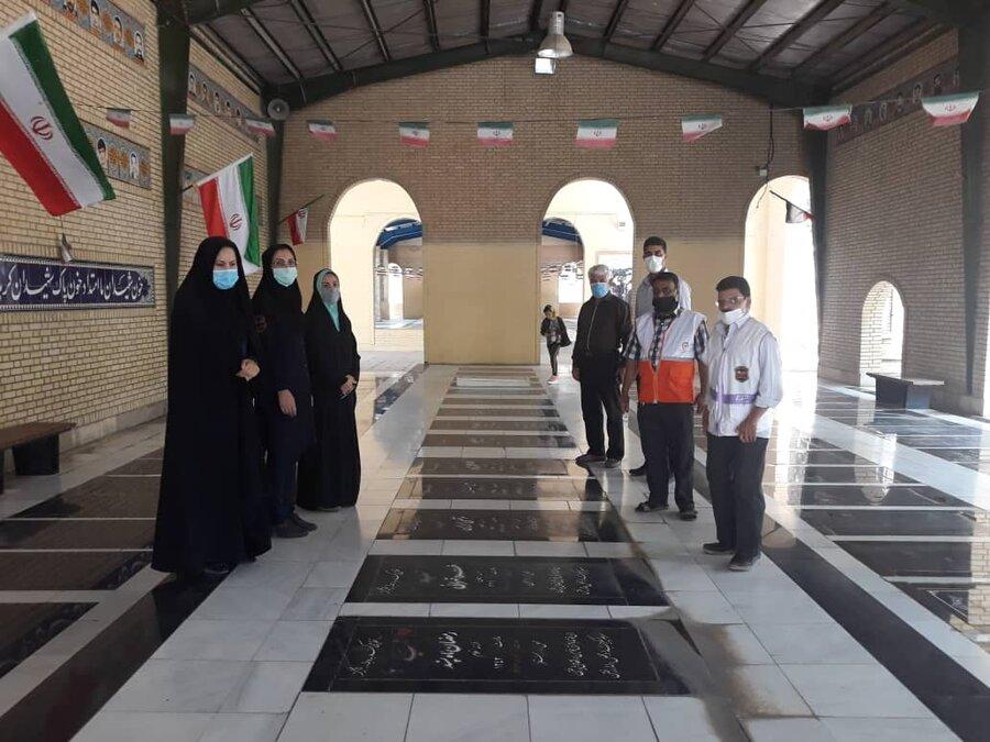 شهر قدس  غبار روبی مزار شهدای هشت سال دفاع مقدس انجام شد