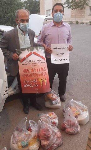 فیروزکوه  توزیع بسته های معیشتی میان خانواده زندانیان
