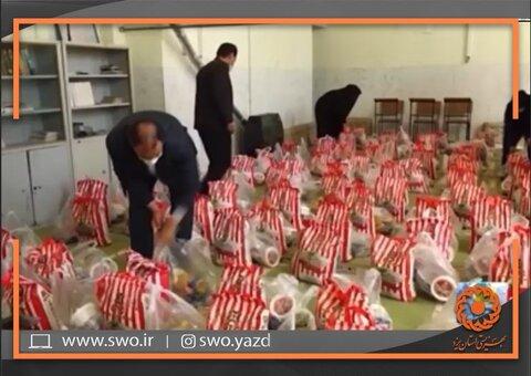 مهریز | ویدیو |  توزیع ۱۰۰  بسته معیشتی و ۲۸ عدد گوشی تلفن همراه
